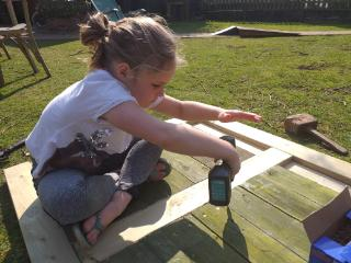 Holly helping Dad with carpentry